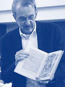 Edward Tufte giving a class and holding a scanned copy of a first edition book by Galileo. Photo by Aaron Fulkerson